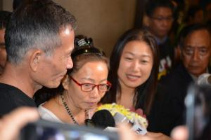 Ta Phong Tan answers questions about her time in prison during an impromptu press conference outside the international terminal at LAX Saturday evening. Flanking her is state Sen. Janet Nguyen and Hai Van Nguyen, Ta's colleague.