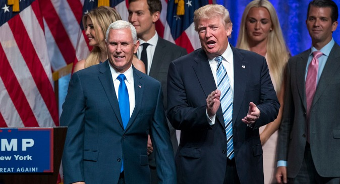 Republican presidential candidate Donald Trump, right, introduces Gov. Mike Pence, R-Ind., during a campaign event to announce Pence as the vice presidential running mate on, Saturday, July 16, 2016, in New York. In their first joint appearance, Trump tried to draw a sharp contrast between Pence, a soft-spoken conservative, and Hillary Clinton, the Democratic presidential candidate. (AP Photo/Evan Vucci)