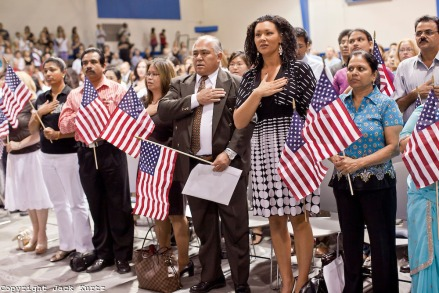 """July 2 - PHOENIX, AZ: New US citizens take the oath of citizenship at South Mountain Community College in Phoenix, Friday. Nearly 200 people were sworn in as US citizens during the """"Fiesta of Independence"""" at South Mountain Community College in Phoenix, AZ, Friday. The ceremony is an annual event on th 4th of July weekend and usually the largest naturalization ceremony of the year in the Phoenix area.  Photo by Jack Kurtz"""