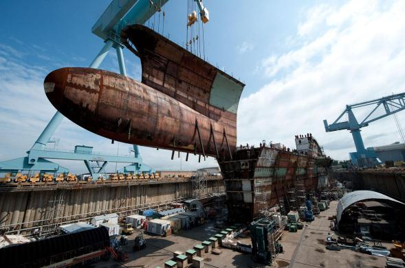 The lower bow unit for the aircraft carrier, Gerald R. Ford (CVN 78)  is lifted in place 5/24/2102.  The Ford, the first ship in a new class of nuclear-powered carriers is under construction at Newport News Shipbuilding.  Photo by Ricky Thompson, Newport News Shipbuilding.