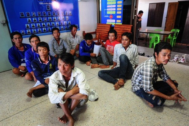 Vietnamese fishermen are held at a police station after being detained in Thai waters for illegal fishing by the Royal Marine Police in Thailand's southern province of Narathiwat on August 1, 2016. / AFP PHOTO / MADAREE TOHLALA