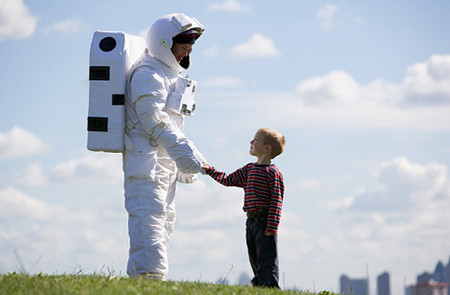 Astronaut shaking a young boy's hand