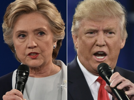 (COMBO) This combination of pictures created on October 09, 2016 shows Democratic presidential candidate Hillary Clinton and Republican presidential candidate Donald Trump during the second presidential debate at Washington University in St. Louis, Missouri on October 9, 2016. / AFP / Paul J. Richards (Photo credit should read PAUL J. RICHARDS/AFP/Getty Images)