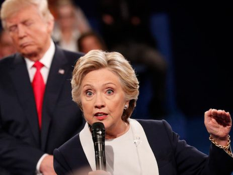TOPSHOT - Democratic nominee Hillary Clinton (R) and Republican Presidential nominee Donald Trump participate in a town hall debate at Washington University in St. Louis, Missouri, on October 9, 2016.  / AFP / POOL / RICK WILKING        (Photo credit should read RICK WILKING/AFP/Getty Images)