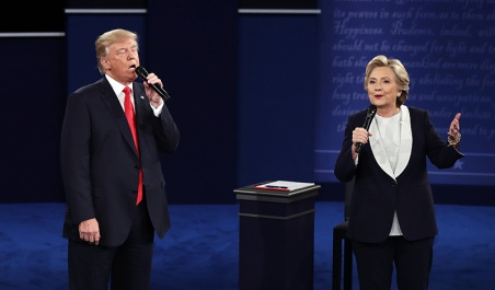 ST LOUIS, MO - OCTOBER 09:  Republican presidential nominee Donald Trump (L) and Democratic presidential nominee former Secretary of State Hillary Clinton speak during the town hall debate at Washington University on October 9, 2016 in St Louis, Missouri. This is the second of three presidential debates scheduled prior to the November 8th election.  (Photo by Win McNamee/Getty Images)