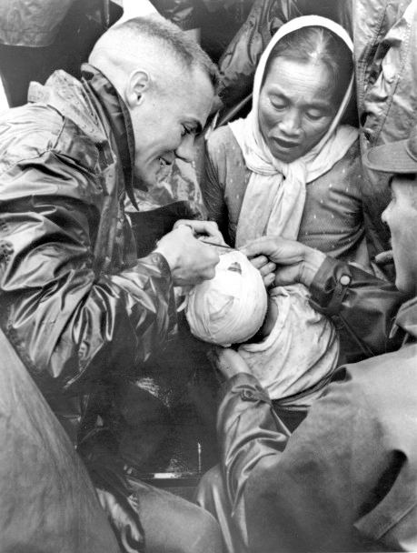 a-us-marine-doctor-removes-bandages-from-a-vietnamese-boy-brought-in-by-his-mother-for-treatment-of-a-head-infection