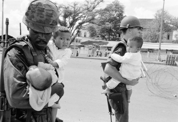 american-soldiers-carrying-children-during-second-offensive-on-saigon