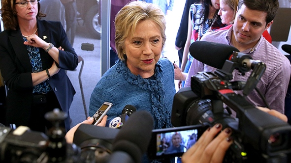 WEST PALM BEACH, FL - MARCH 15: Democratic presidential candidate Hillary Clinton talks to members of the media during a visit to a Dunkin' Donuts on March 15, 2016 in West Palm Beach, Florida. Clinton is campaigning in North Carolina before traveling to Florida to hold a primary night event. (Photo by Justin Sullivan/Getty Images)