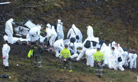 EDS NOTE: GRAPHIC CONTENT - Rescue workers arrange the bodies of victims of an airplane that crashed in a mountainous area outside Medellin, Colombia, Tuesday, Nov. 29, 2016. The plane was carrying the Brazilian first division soccer club Chapecoense team that was on it's way for a Copa Sudamericana final match against Colombia's Atletico Nacional. (AP Photo/Luis Benavides)