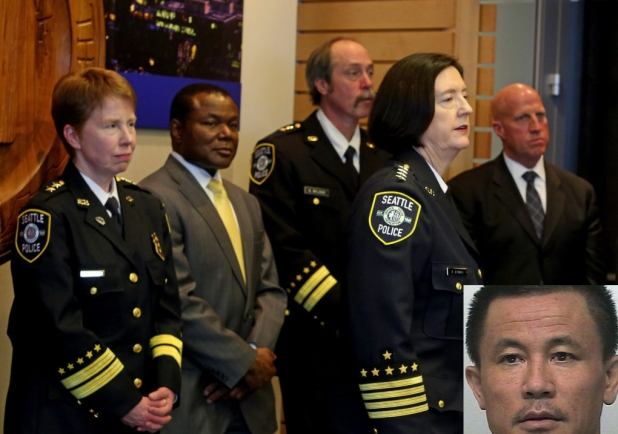 Seattle Police Chief Kathleen O'Toole, in uniform at right, introduces her four new assistant chiefs. From left Lt. Lesley Cordner, Parry Tarrant, from Yakima PD, Capt. Steve Wilske, and Superintendent Robert Merner, from Boston Police Department. Cordner and Wilske are from Seattle Police Department.    (Greg Gilbert / The Seattle Times)