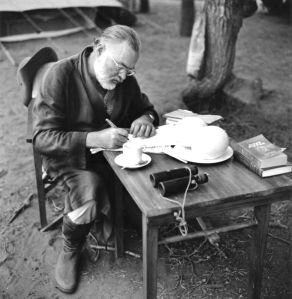 KENYA - SEPTEMBER 1952:  Author Ernest Hemingway writes at a portable table while on a big game hunt in September 1952 in Kenya.  (Photo by Earl Theisen/Getty Images)